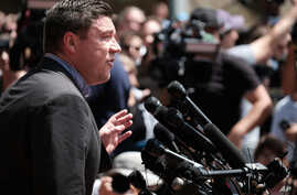 FILE - Unite The Right rally organizer Jason Kessler attempts to speak at a press conference in front of Charlottesville City Hall in Charlottesville, Virginia,  Aug. 13, 2017.