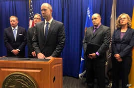 U.S. Attorney John Anderson, center at podium, speaks about the investigation into a fugitive Catholic priest who is accused of sex abuse at a news conference, Sept. 21, 2018, in Albuquerque, N.M. Federal authorities said FBI agents returned 80-year-