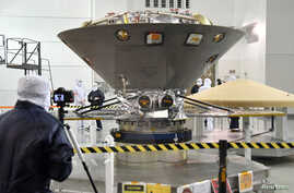 FILE - NASA's InSight spacecraft, destined for the Elysium Planitia region in Mars' northern hemisphere, undergoes final launch preparations at Vandenberg Air Force Base, Calif., April 6, 2018.
