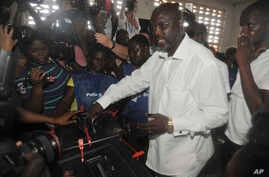 Former soccer star George Weah, Presidential candidate for the Coalition for Democratic Change cast his vote during a Presidential election in Monrovia, Liberia. Tuesday Oct. 10, 2017.