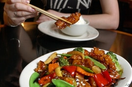 FILE- A sample of a plate of General Tso's Chicken in New York. Chef Peng Chang-kuei, the chef who has been credited with inventing world-famous Chinese food staple that is not served in China, died at age 98, on Nov. 30, 2016.