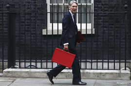 Britain's Chancellor of the Exchequer Phillip Hammond arrives in Downing Street in London, Britain Sept. 7, 2016.