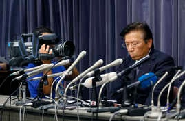 Mitsubishi Motors Corp. President Tetsuro Aikawa listens to a reporter's question during a press conference in Tokyo, Wednesday, May 18, 2016. Aikawa said Wednesday that he will step down to take responsibility for the mileage cheating scandal unfold