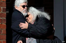 Susan Bro, mother of Heather Heyer, hugs her husband, Kent in front of Charlottesville Circuit Court after a jury recommended life plus 419 years for James Alex Fields Jr. for the death of Heyer as well as several other charges related to the Unite t