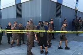 UPS workers are seen gathered outside after a reported shooting at a UPS warehouse and customer service center in San Francisco, California, June 14, 2017.
