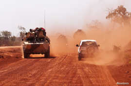 FILE - Troops drive to Segou, Jan. 16, 2013. Gunmen ambushed a convoy Tuesday, killing four soldiers.