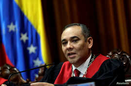 FILE - Venezuela's Supreme Court President Maikel Moreno, shown reading a statement in Caracas, Venezuela, Aug. 1, 2017, is one of the officials targeted with the latest round of EU sanctions.
