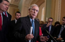 Senate Majority Leader Mitch McConnell, R-Ky., joined at left by Sen. John Barrasso, R-Wyo., and Sen. Todd Young, R-Ind., speaks to reporters asking about the threat of another government shutdown following a strategy meeting in Washington,  Jan. 29,...