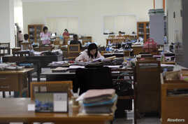 FILE - Employees work at the Central Bank's headquarters in Naypyitaw, Myanmar.