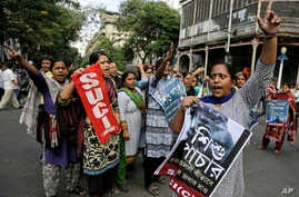 FILE - Activists of Socialist Unity Center of India-Marxist (SUCI-M) protest a recent case of child trafficking in West Bengal state in Kolkata, India, Nov. 29, 2016. Officials busted a child trafficking racket and rescued more than 20 children, acco