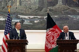 Afghan President Ashraf Ghani, right, speaks during, a press conference with U.S. Secretary of State Mike Pompeo, at the presidential palace in Kabul, July 9, 2018. Pompeo used an unannounced trip Monday to Afghanistan to step up the Trump administra
