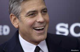 "Cast member George Clooney arrives for the premiere of his movie ""The Monuments Men"" in New York, Feb. 4, 2014."