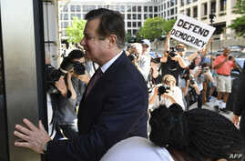 FILE - Paul Manafort arrives for a hearing at US District Court on June 15, 2018 in Washington, DC.