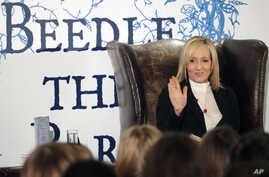 "Author J.K. Rowling reads passages from her book ""The Tales of Beedle the Bard"" to about 200 schoolchildren at a tea party in the  Parliament Hall Edinburgh, Dec, 4, 2008."