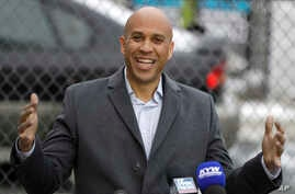 U.S. Sen. Cory Booker, D-NJ, speaks during a news conference outside of his home, Feb. 1, 2019, in Newark, N.J.