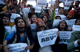 Members of Indian students organization ABVP shout slogans as they protest the release of a juvenile convicted in the fatal 2012 gang rape that shook the country in New Delhi, India, Dec.20, 2015.