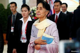 Myanmar State Counselor Aung San Suu Kyi walks between meetings at the ASEAN Summit in Vientiane, Laos Sept. 6, 2016.