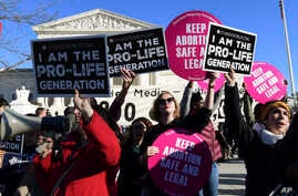 FILE - Protesters on both sides of the abortion issue gather outside the Supreme Court in Washington, Jan. 19, 2018, during the March for Life. The march falls each year around the anniversary of the 1973 Roe v. Wade decision that recognized a legal ...