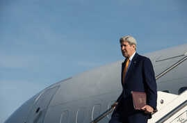 U.S. Secretary of State John Kerry gets off his plane upon his arrival at Rome's Ciampino airport, Feb. 1, 2016.