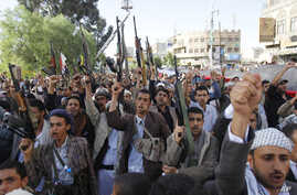 Shiite rebels, known as Houthis, chant slogans as they hold up their weapons during a demonstration against an arms embargo imposed by the U.N. Security Council on Houthi leaders, in Sanaa, Yemen, April 16, 2015.