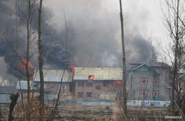 A house where suspected militants were holding up is seen in flames during a gun battle with Indian security forces in Pinglan village in south Kashmir's Pulwama district, Feb. 18, 2019.