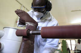 A worker prepares a prosthesis inside the manufacturing workshop of the Physical Rehabilitation Reference Centre in Juba, South Sudan, July 7, 2011. The center, run by the Government of South Sudan in cooperation with the International Committee of
