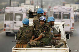 FILE- U.N. soldiers from Niger conduct a patrol through the streets of Abidjan, Ivory Coast, Jan. 10, 2011. The U.N. peacekeeping mission in Ivory Coast ended June 30, 2017, 13 years after forces intervened to implement a peace agreement that left th