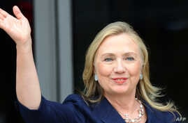 US Secretary of States Hillary Clinton waves as she arrives to attend the Asia-Pacific Economic Cooperation (APEC) summit on September 8, 2012.
