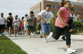 Children and teens take off from the starting line for the annual run/walk for patients and their friends and families at The Children's Hospital in Aurora, Colorado June 5, 2010. The Children's Hospital host a 10-week Shapedown Program, which has a
