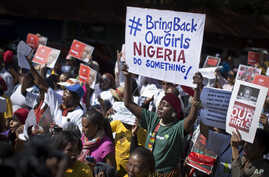 South Africans protest in solidarity against the abduction three weeks ago of hundreds of schoolgirls in Nigeria, May 8, 2014.