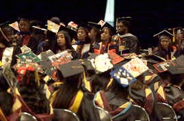 A group of students stand and turn their backs during a commencement exercise speech by U.S. Secretary of Education Betsy DeVos at Bethune-Cookman University in Daytona Beach, Fla., May 10, 2017.