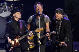 FILE - In this Tuesday, March 15, 2016, photo, Bruce Springsteen (C) performs with Nils Lofgren (L) and Steven Van Zandt of the E Street Band during their concert at the Los Angeles Sports Arena in Los Angeles.