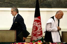 In this Sept. 21, 2014, photo, Afghanistan's then presidential candidates Abdullah Abdullah (L) and Ashraf Ghani leave after signing a power-sharing deal at the presidential palace in Kabul, Afghanistan.