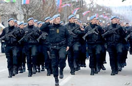 Members of police forces of Republic of Srpska march during a parade marking 25th anniversary of Republic of Srpska in the Bosnian town of Banja Luka, Bosnia, Jan. 9, 2017.