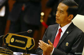 """FILE - Indonesia's President Joko Widodo, shown at an ASEAN summit meeting last year in Naypyitaw, Myanmar, says he has """"not received any information on threats of a security breach. That means we are safe."""""""
