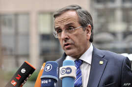 Greek Prime Minister Antonis Samaras answers journalists' questions as he arrives to attend a European Council meeting at the EU headquarters in Brussels, Oct. 24, 2013