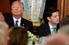 "President Donald Trump, left, sits with House Speaker Paul Ryan on Capitol Hill in Washington during a ""Friends of Ireland"" luncheon, March 16, 2017."