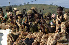 FILE - Chadian soldiers are seen sitting atop a pickup truck.