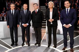 From left to right, Conservative presidential candidate Francois Fillon, Independent centrist presidential candidate for the presidential election Emmanuel Macron, Far-left presidential candidate for the presidential election Jean-Luc Melenchon, Far-