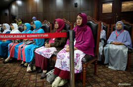 Family Love Alliance (AILA) members attend a trial at Indonesia's constitutional court in Jakarta, Indonesia, Dec. 14, 2017. The court denied their petition.