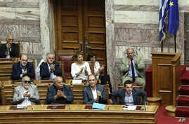 Greek Prime Minister Alexis Tsipras, front right, acknowledges applause after delivering his speech during a parliamentary session in Athens, Aug. 14, 2015.