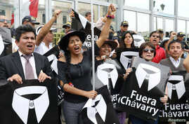 "People hold placards reading ""Chavarry out"" referring to Peru Attorney General Pedro Chavarry, during a protest outside the Attorney General's Office in Lima, Peru, Jan. 8, 2019."
