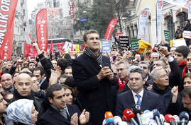 FILE - Turkey's main opposition Republican People's Party (CHP) mayoral candidate Mustafa Sarigul (C) speaks during a protest against Turkey's ruling AK Party and Prime Minister Tayyip Erdogan in Istanbul.