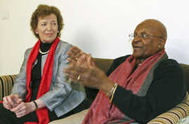 South African Archbishop and Nobel Laureate Desmond Tutu (R) speaks as former President of Ireland Mary Robinson watches during an interview in New Delhi, February 8, 2012.