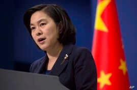 FILE - Chinese Foreign Ministry spokeswoman Hua Chunying speaks during a briefing at the Chinese Foreign Ministry in Beijing.