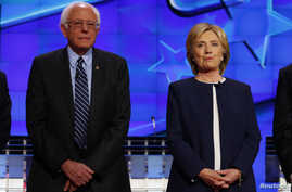 Democratic presidential candidate Senator Bernie Sanders and former Secretary of State Hillary Clinton stand together before the start of the first official Democratic candidates debate of the 2016 presidential campaign in Las Vegas, Nevada Oct. 13,