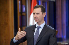 Syria's President Bashar al-Assad speaks during an interview with Fox News channel in Damascus, in this handout photograph distributed by Syria's national news agency SANA, Sept. 19, 2013.
