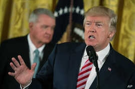 President Donald Trump speaks at a Air Traffic Control Reform Initiative announcement in the East Room at the White House,  June 5, 2017, in Washington.