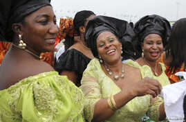 """Delegates from Delta state take part in a parade during the """"peace rally"""" organized by the National Council for Women's Societies (NCWS) in Abuja, Nigeria, Aug. 15, 2013."""