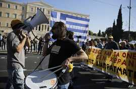 Demonstrators protest against the government's austerity policies outside the Greek Parliament during a 24-hour nationwide general strike Nov. 12, 12015, in Athens.